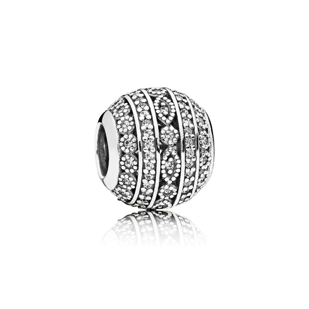 Charm in sterling silver with clear cubic zirconia and milgrain details