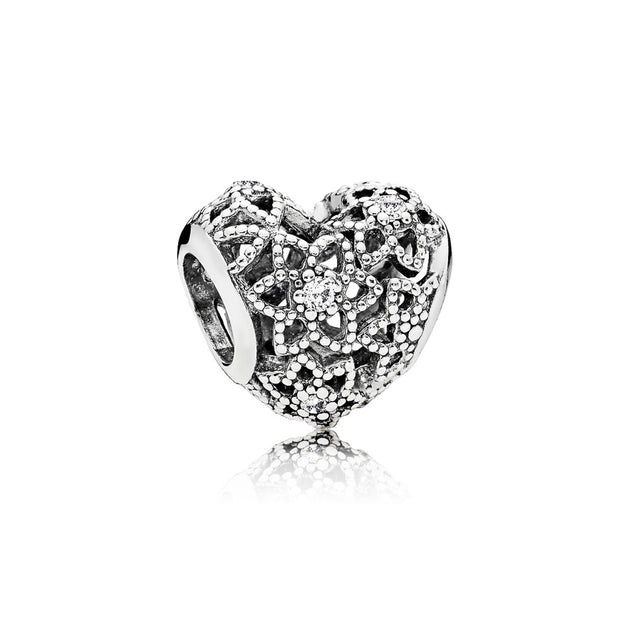 Openwork heart charm in sterling silver with clear cubic zirconia in floral pattern