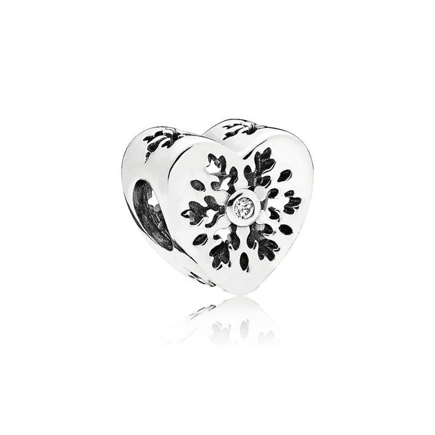 Snowflake heart charm in sterling silver with clear cubic zirconia and snowflake details