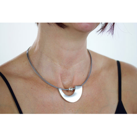 folded oval  penant with sterling bead on stainless cords