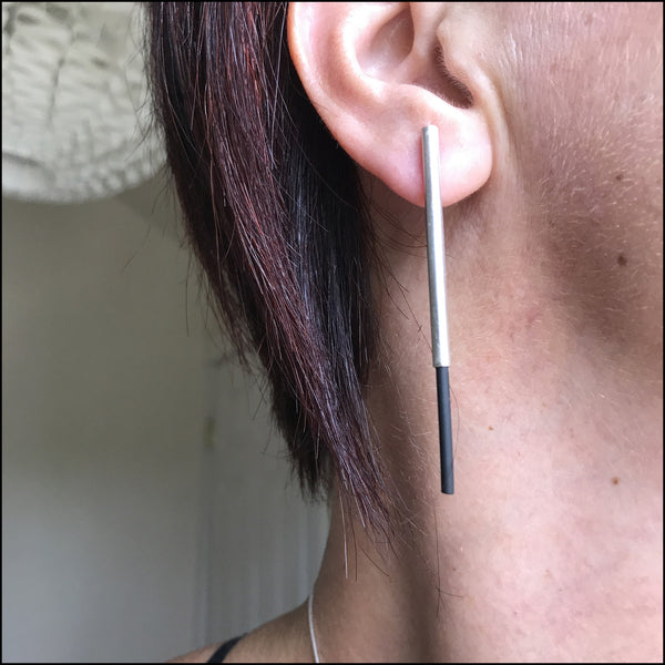tube with black rubber post earrings
