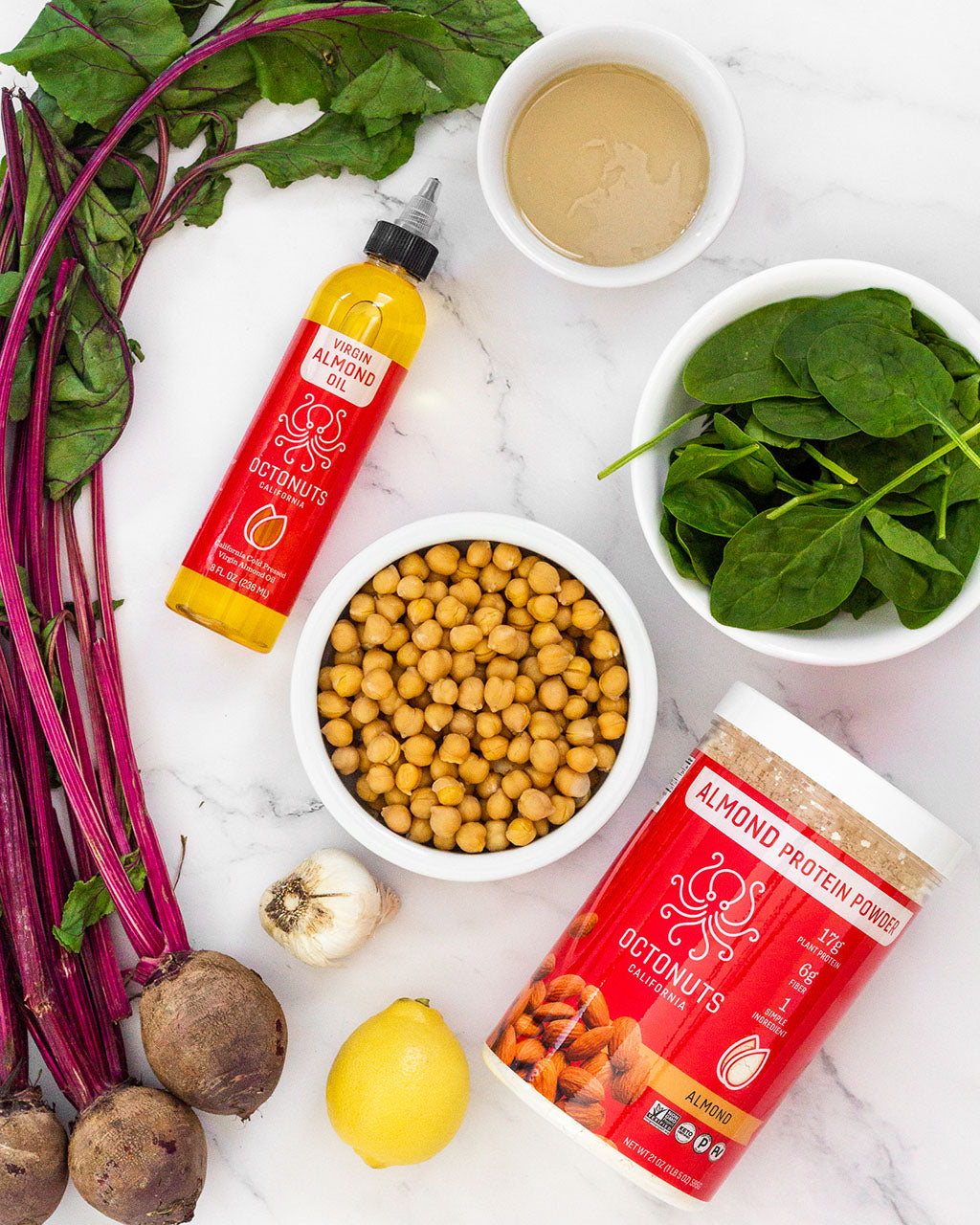Ingredients for plain, beet, and spinach hummus with Octonuts Almond Oil