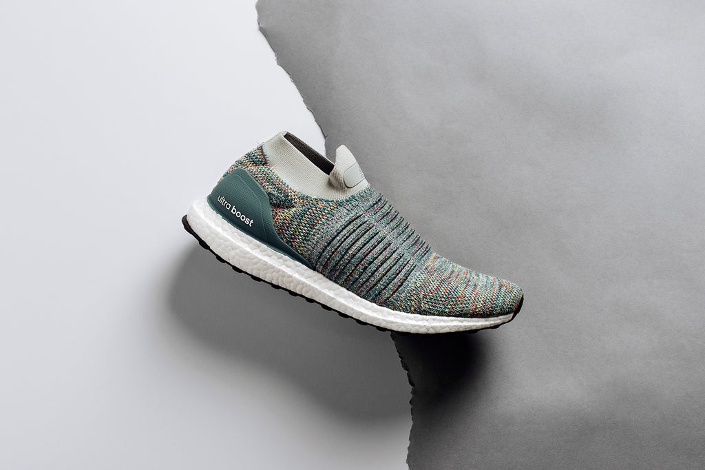 265ca94906a1 Adidas expands their laceless Ultraboost collection with a multi-colored  rendition ( 200). The upper of this variation features a predominately