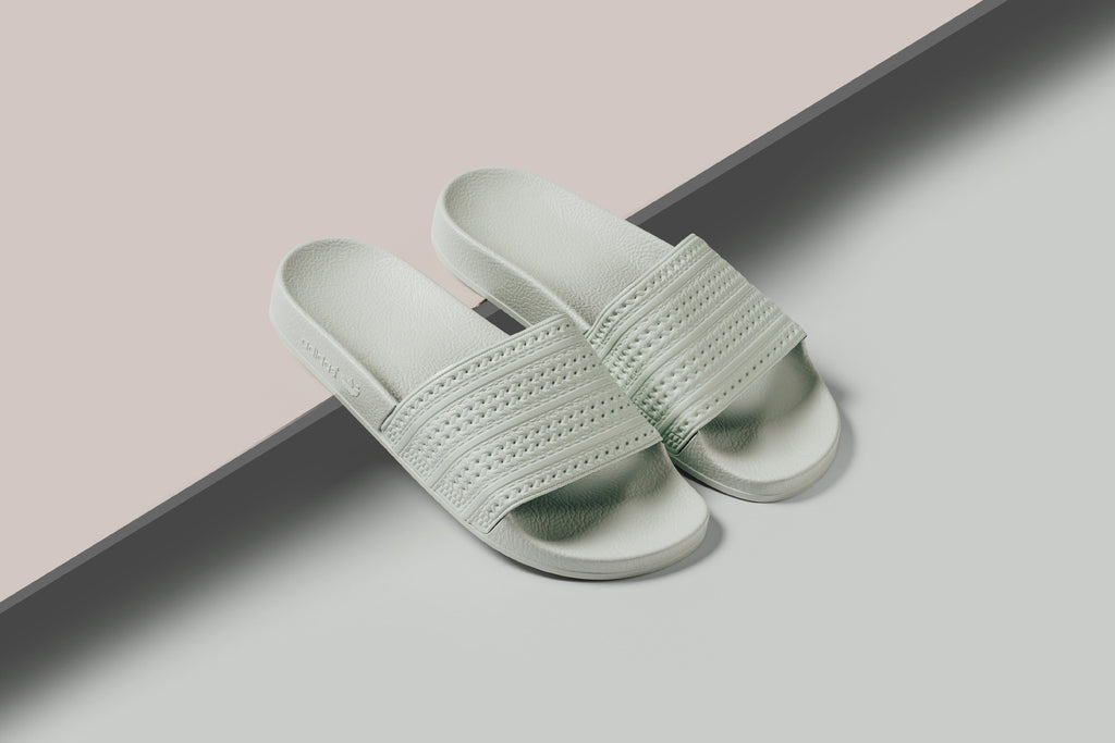 e6652f35c988 Adidas delivers a small selection of summer-ready slides ( 45) for the  hotter days to come. The iconic Adilette model gets treated to two new  pastel colors