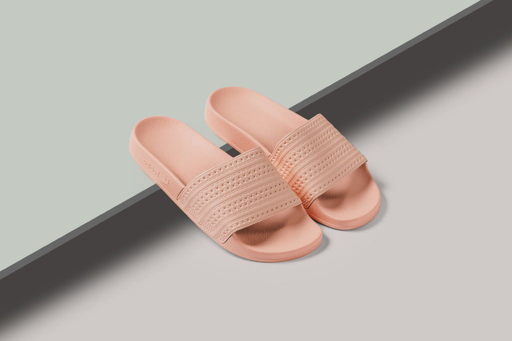 a00608b14 Adidas delivers a small selection of summer-ready slides ( 45) for the  hotter days to come. The iconic Adilette model gets treated to two new  pastel colors