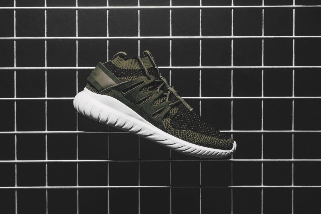 cheap for discount d45a7 cc61f Adidas delivers the Tubular Nova ( 140) in a perfect colorway for fall.  This rendition features a full prime knit construction in a black and olive  color ...