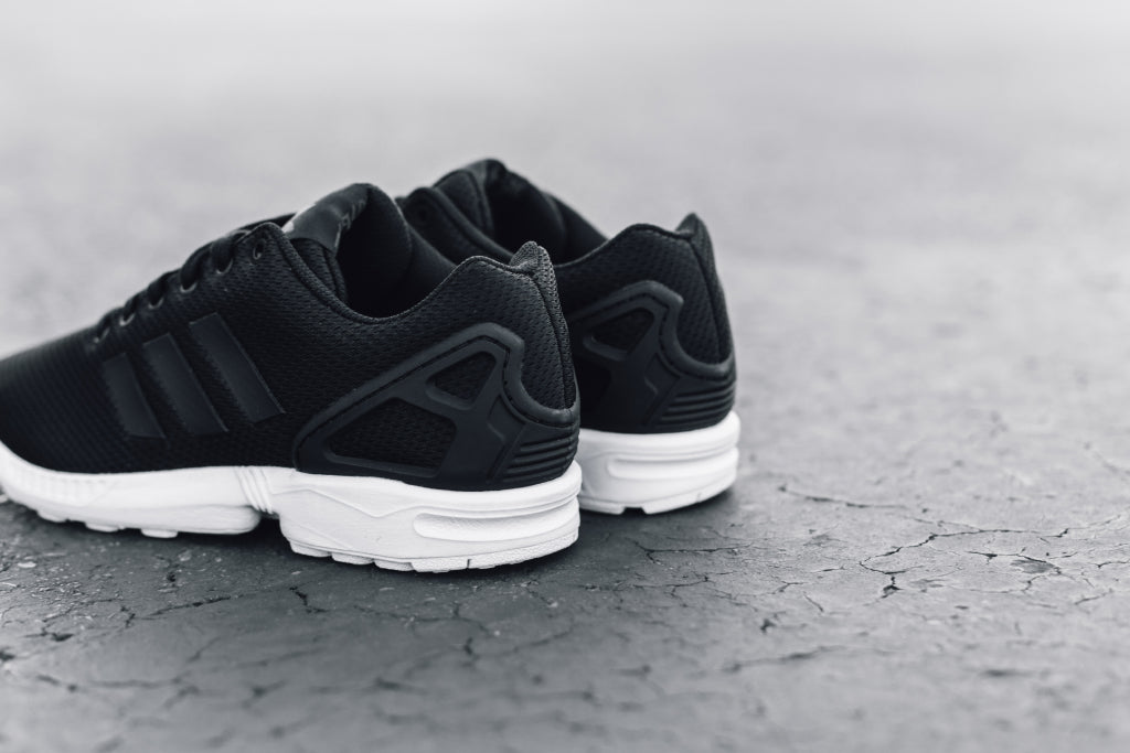 buy online 366e5 3a971 Adidas Originals ZX Flux In Black Available Now – Feature