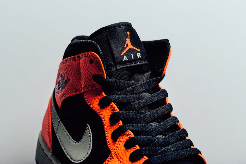 2d0cf92a33d The Air Jordan 1 Mid ( 110) is back just in time for the Halloween  celebrations. This time around the lowered iteration of the classic sports  a bright and ...