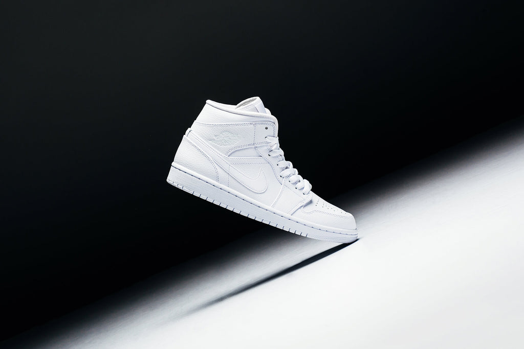 d404db630c3 Jordan Brand presents a mid cut rendition the the classic Air Jordan 1 in a  triple white color-way ($110). The timeless silhouette kicks off with a  premium ...
