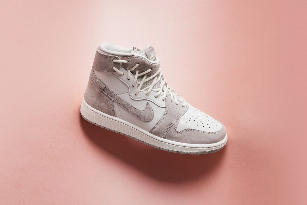 Jordan Brand presents a new rendition of the women s Jordan 1 Rebel XX  dressed in a Moon Particle hue 49cf3f5931d