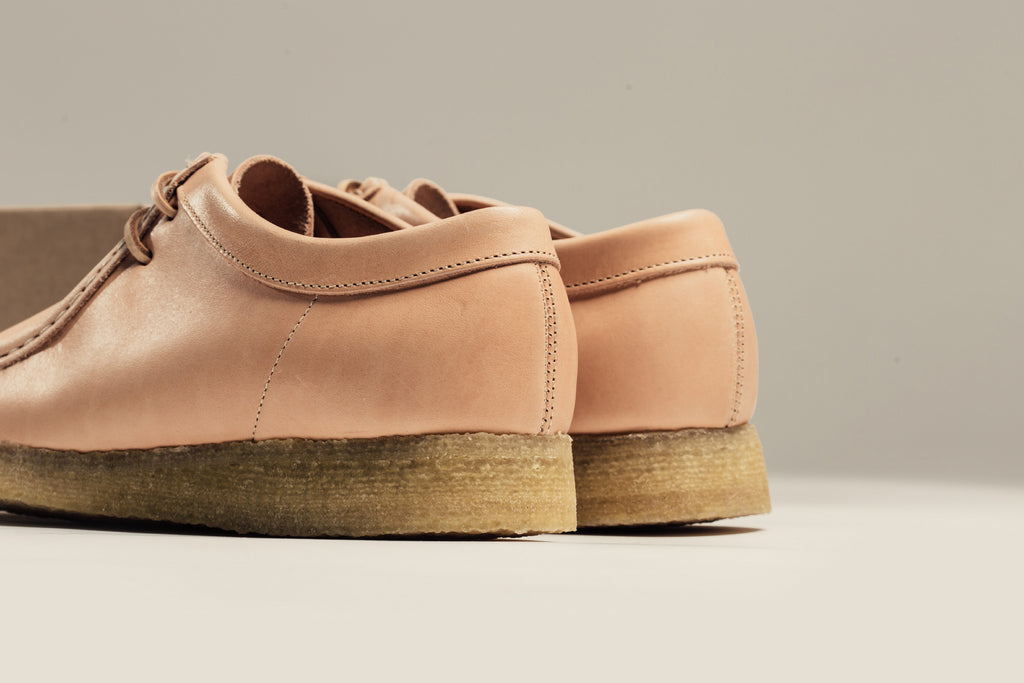 huge discount 6dc6f 83304 Clarks presents their iconic Wallabee boot with a timeless construction.  This rendition is seen suited in a natural tan leather, made to age with  wear.