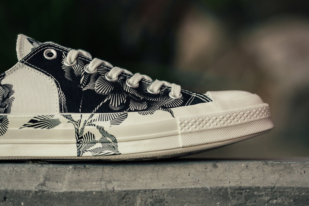 c9097e1d65eb Converse presents a special iteration of the All Star Chuck  70 Low with a  black and Egret colorway featuring an intricate floral pattern throughout  ( 90).