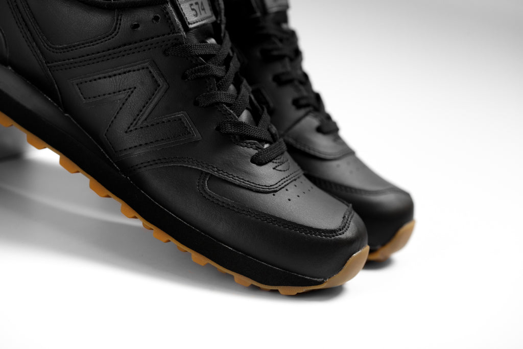 new balance all black shoes