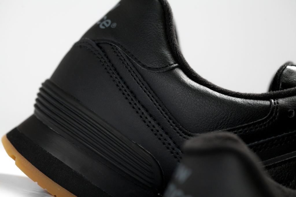 new balance 574 leather black with gum