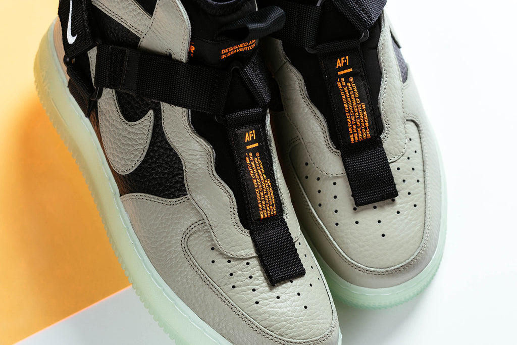 c07b234908a38 Nike continues to push the limits with their favorite blank canvas the Air  Force One, bringing us the AF1 utility in mid. This model tosses out the  lacing ...