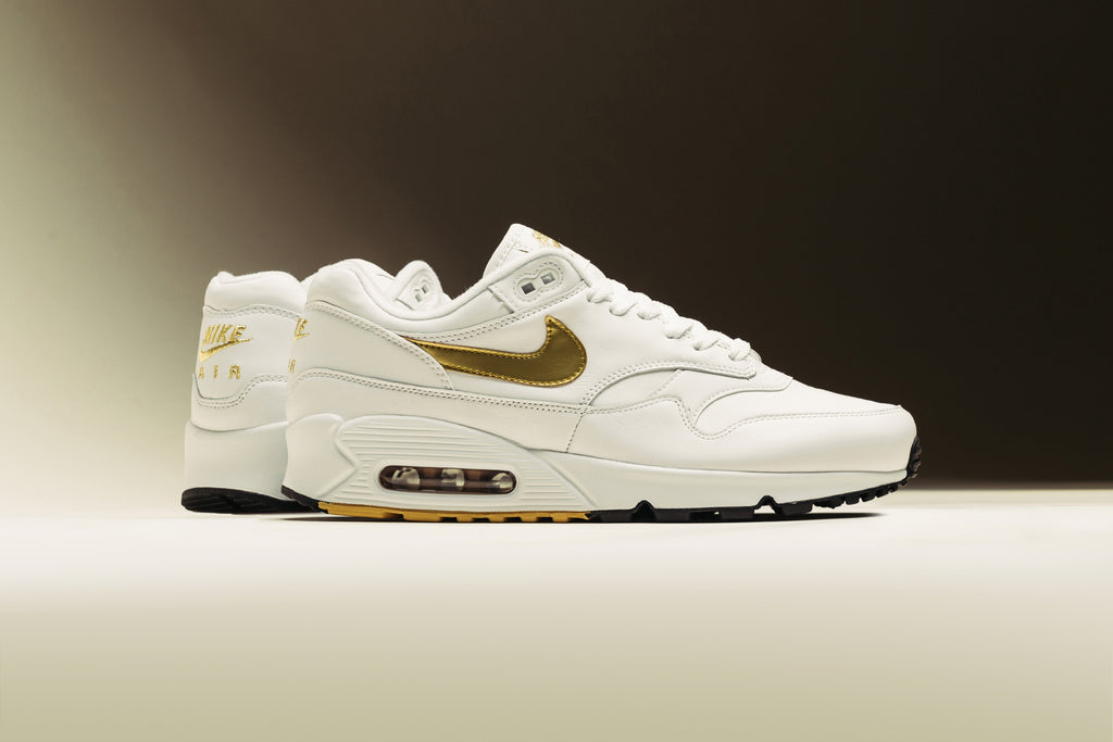 timeless design ba867 6ec2e Nike presents a new iteration of their hybrid model, the Air Max 90 1  dressed in a luxurious white colorway highlighted by metallic gold details  ( 140).