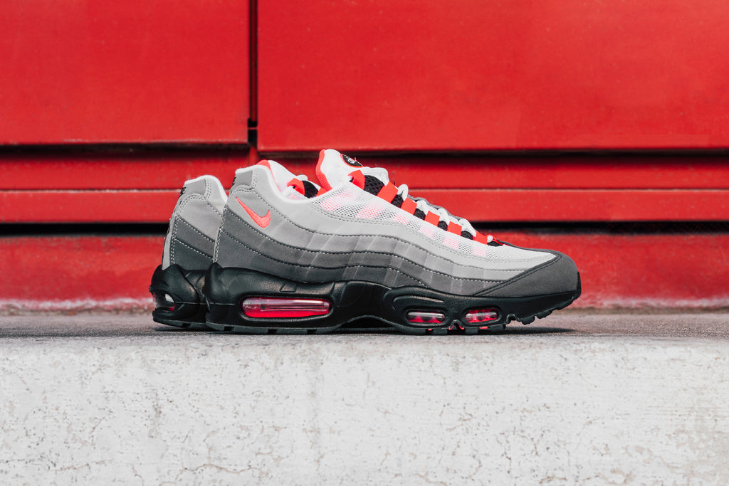 100% authentic c0768 efb94 Nike reintroduces a classic with the Air Max 95 OG, featuring a White and  Granite upper highlighted by a familiar Solar Red Swoosh logo and lace  details ...