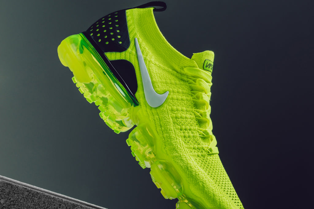 a6537a5b2db9e Nike presents a new iteration of the Air VaporMax Flyknit 2 highlighted by  a primarily volt colorway with black and white compliments ( 190).