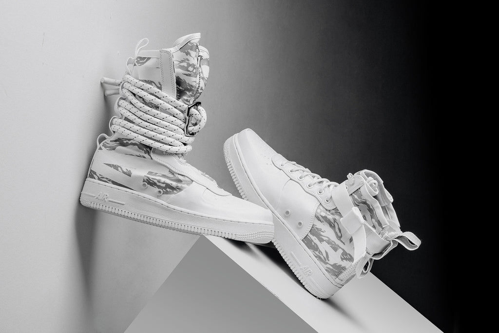 f49fd29aafe57 Nike expands their Special Field Air Force 1 collection with a duo of white  tiger camo variations. This duo is made up of the new SF AF-1 Hi Boot