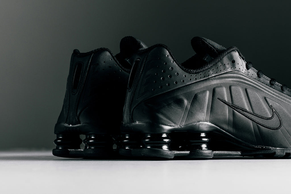 online retailer 6382b 7cfe5 Nike presents a major throwback in the form of the vintage Nike Shox,  pictured in a clean triple black color-way ( 140). First introduced in  1984, ...