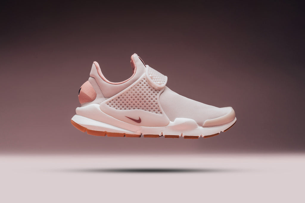 best service 52666 d37ca Nike returns with a Premium take to their Women s Sock Dart silhouette  ( 140). Dressed in a Silt Red color scheme, the sneaker features a  flexible, ...