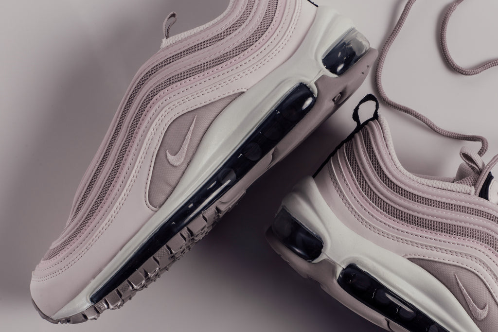c9b45a124c Nike presents women with an exclusive spring themed color-way of the  classic Air Max 97 ($160). The model's multi-material upper is made up of a  combination ...