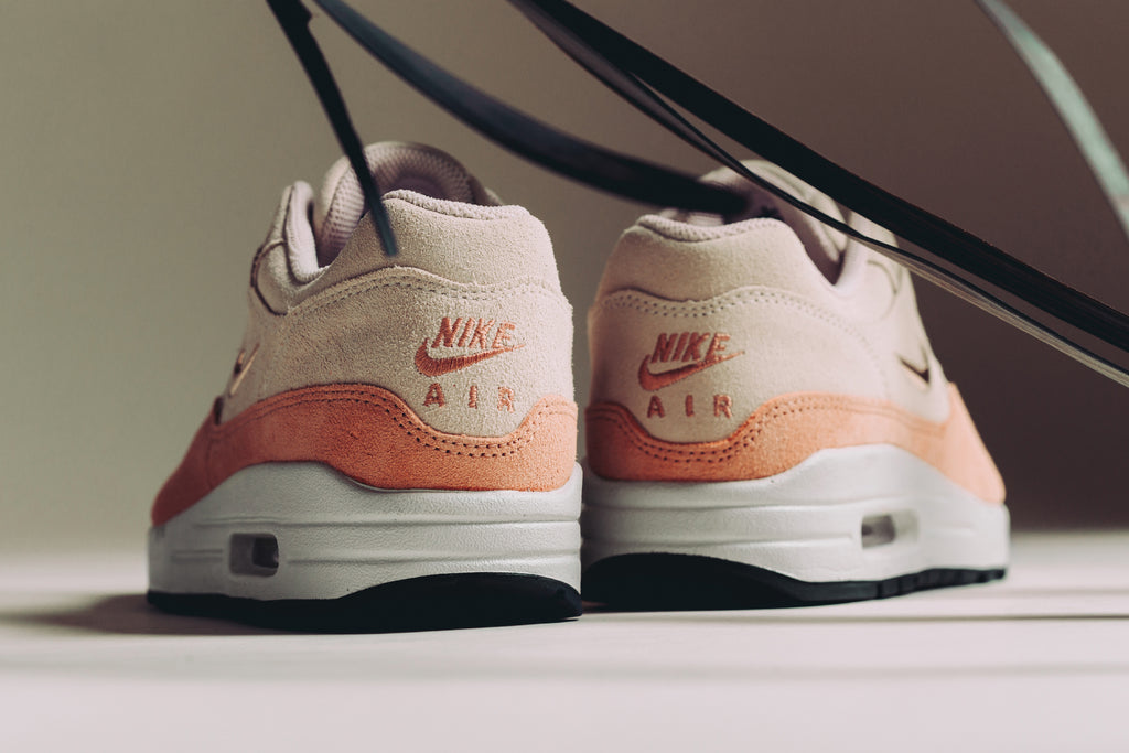 size 40 5b5c3 d312c Nike presents a new rendition of the women s Air Max 1, featuring a guava  ice colored upper with hints of complimenting terra blush and red bronze  details ...