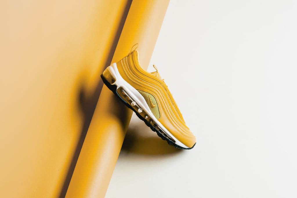 separation shoes 442c5 d305c Nike presents a bright iteration of the popular Air Max 97 for women,  featuring a Mustard colorway with gold and white details (160).