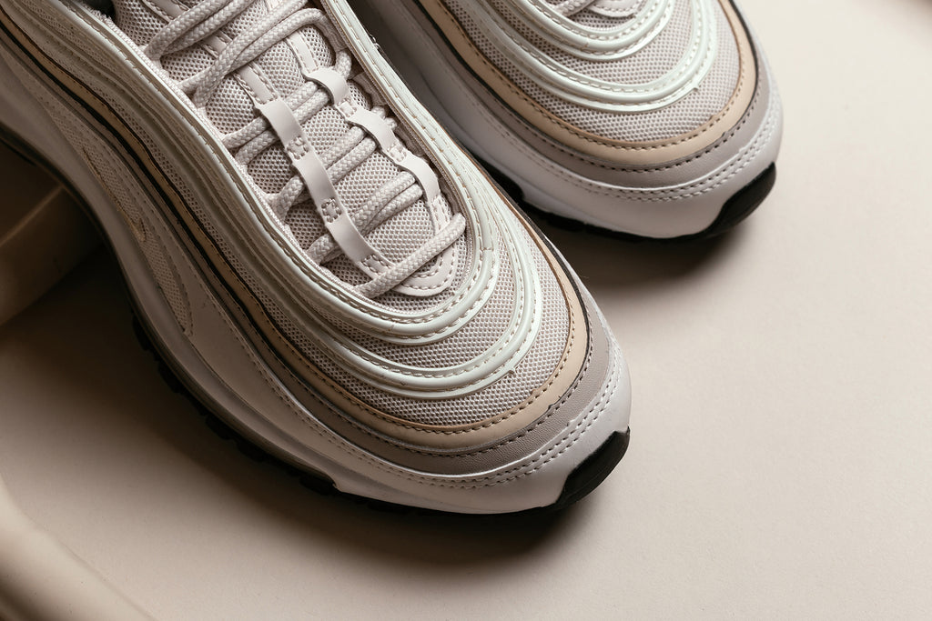 a29a657f0e367 Nike presents a silky rendition of the Air Max 97 for the ladies, featuring  a phantom colored upper with subtle accents of beach and desert sand ($160).
