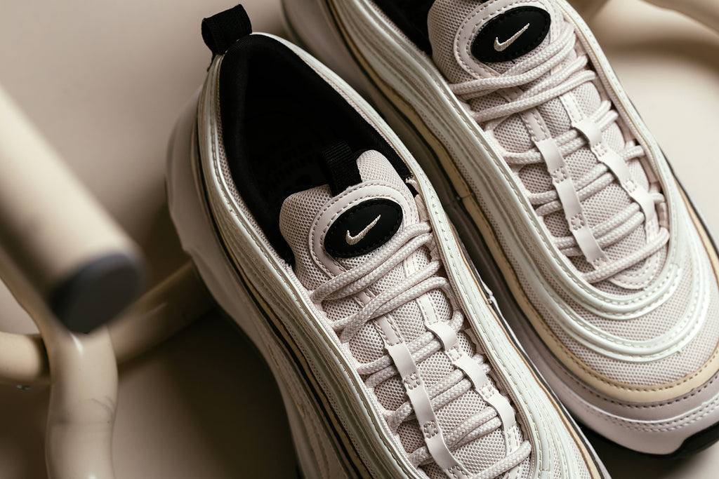 b2f75b85f2 Nike presents a silky rendition of the Air Max 97 for the ladies, featuring  a phantom colored upper with subtle accents of beach and desert sand ($160).