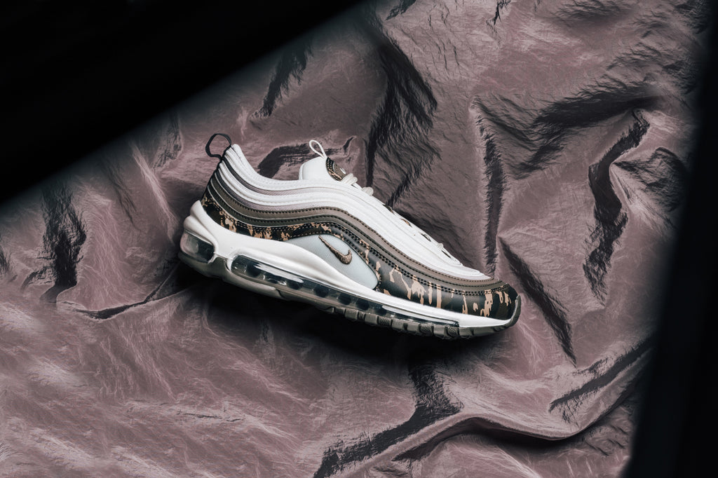 online store c57d3 9e6b1 Nike presents a fall-ready design to their iconic Womens Air Max 97  (170). This time around we see the retro runner showcased with a  predominately white ...