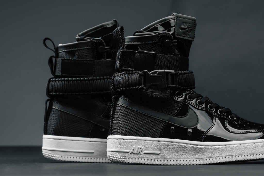"Nike's ""Force Is Female ""Black Patent Leather Pack Is"