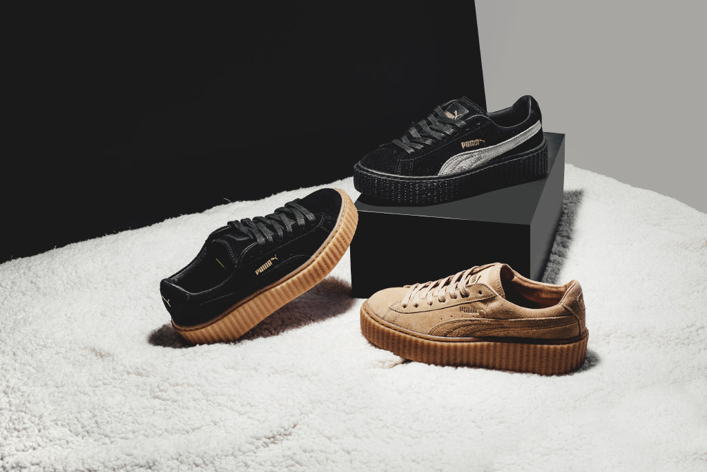 Puma releases their first collection with Rihanna as their women s Creative  Director by remixing the iconic Puma Suede. Adding Rihanna s own rebel look  to ... 364649e2da