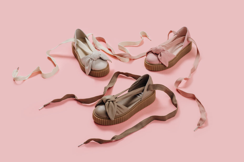 Rihanna expands her FENTY Puma collection ( 180 Each) with a new delivery  of ballet-inspired sandals just in time for summer. The latest range of  footwear ... 192819eb2e