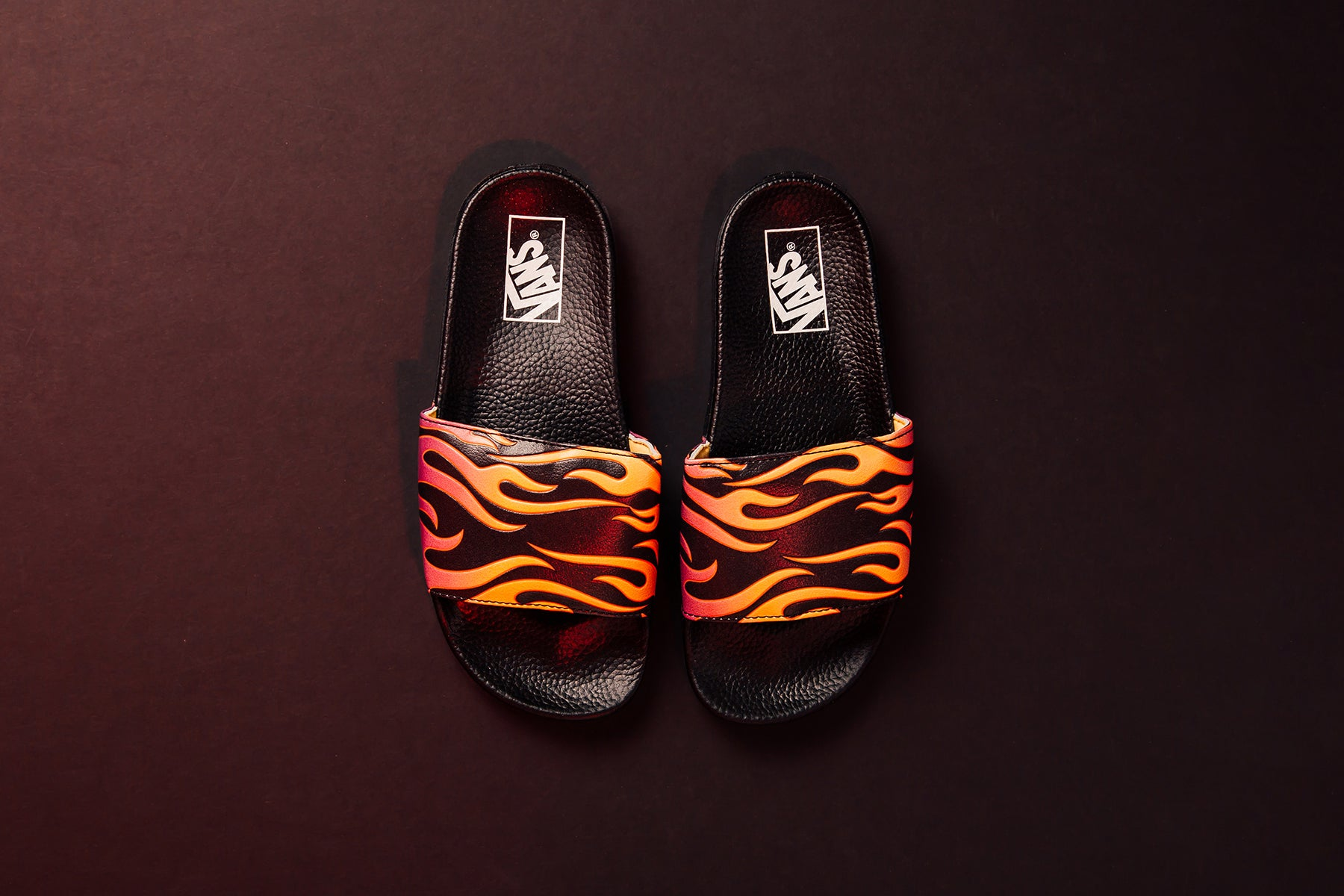 Vans expands their women s offering with another flame iteration - this  time on the newly-designed slide model ( 35). The latest sandals feature  synthetic ... 2fee61770a