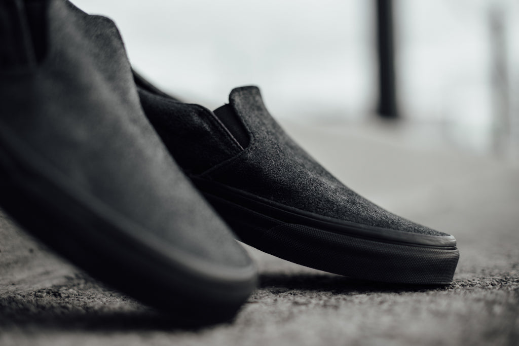 e2ff999541 Vans expands their women s slip-on ( 60) collection with a new  patent  crackle  design. This presentation sports a crackled leather design in a  tonal black ...