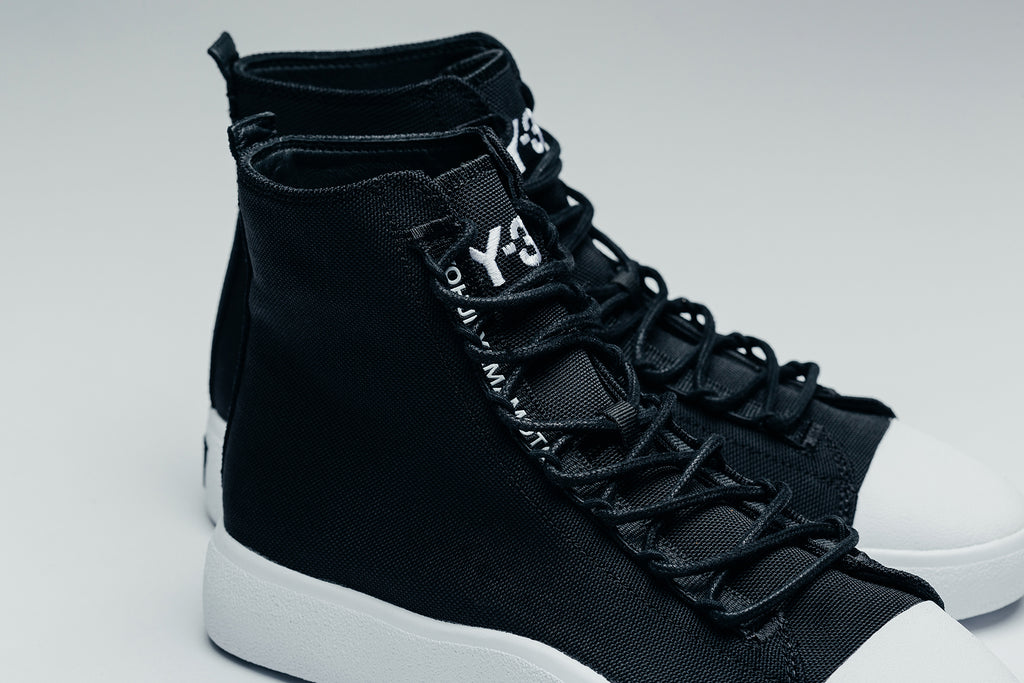 b32935056 Y-3 is a collaborative brand between Adidas and Japanese designer Yohji  Yamamoto. The Y stands for Yohji Yamamoto while 3 represents Adidas  three  signature ...