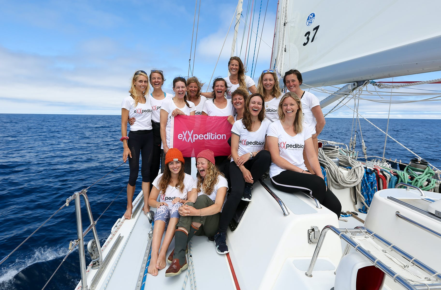 The women of eXXpedition, pictured on their boat in the ocean.