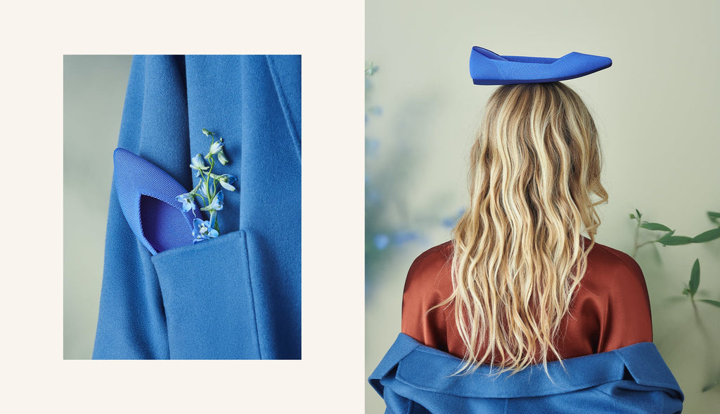 On the left, The Point in Cornflower shown in a pocket of a blue coat. On the right, The Point in Cornflower shown balanced on top of a model's head.