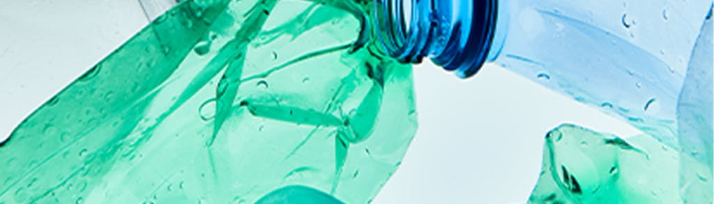 Close up image of green and blue plastic water bottles.