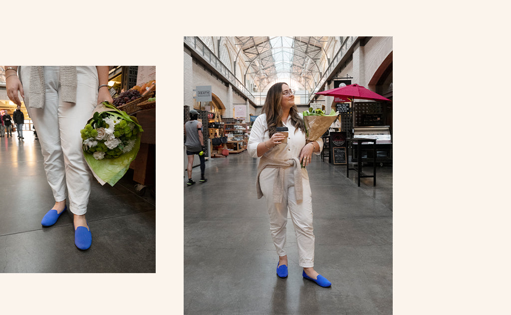 Images showing a Rothy's employee wearing The Loafer in Cornflower, while walking around a farmer's market.