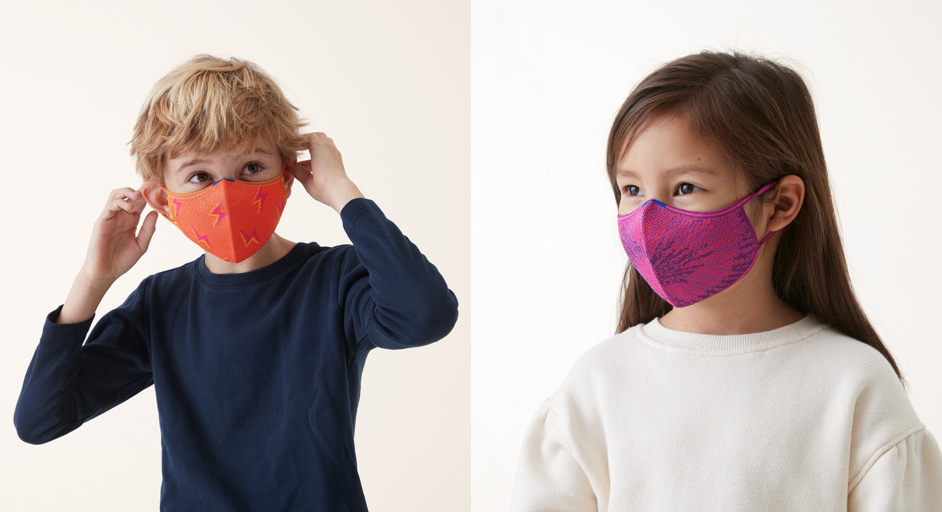 Boy in a navy sweater wearing a bright orange kids mask with a hot pink lightning bold pattern