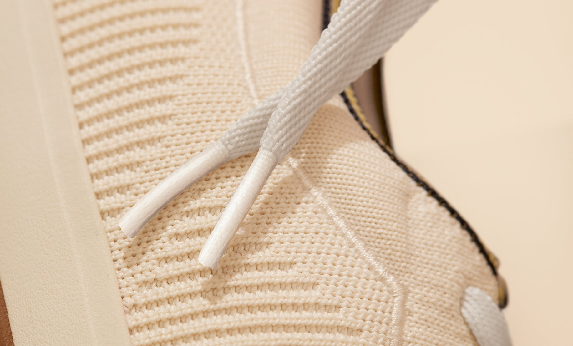 Close up of the side stitching details of The Lace Up in Vanilla.