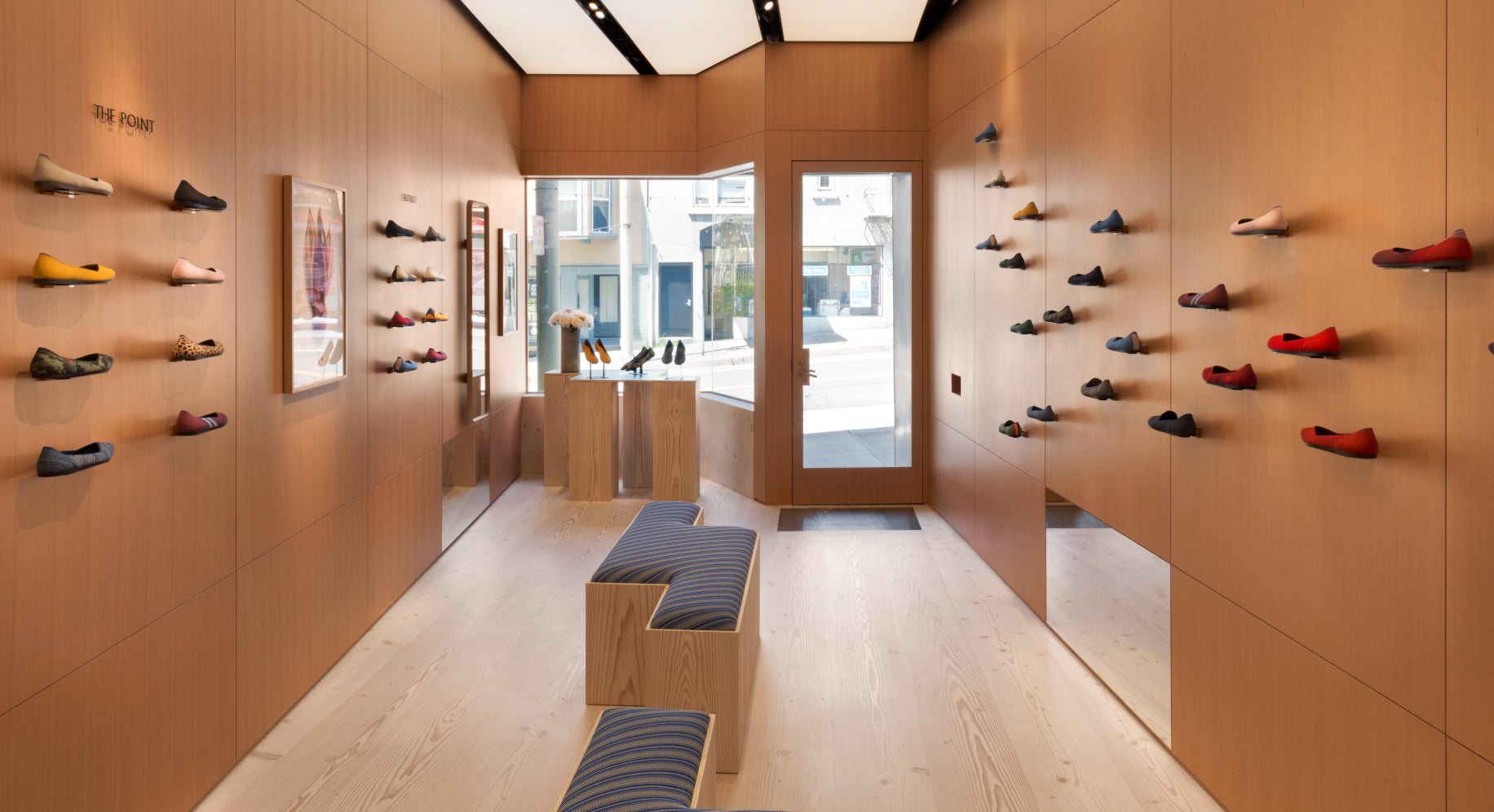 Interior view of our San Francisco retail store, with shoes displayed on the wall.
