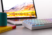 Anne Pro2 60% mechanical keyboard - white base with macbook