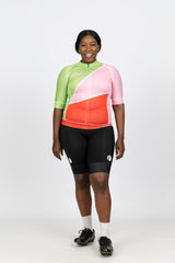 Front view of our beautifully bright and flattering Gelato short sleeve jersey featuring soft Italian lycra and mesh panels on the sides and rear for extra ventilation.  Silicone grips on the arms and waist ensure the jersTey stays in place when riding.  Teamed with our black women's cycling knicks with white logos on each leg.