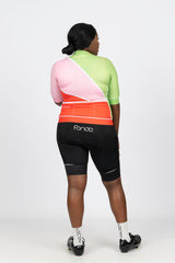 Rear view of short sleeve women's cycling jersey featuring our bright red, green and pink Gelato design.  Shows 3 large rear pockets to carry your essentials and silicone grip at the waist to hold the jersey in place.  Team with our black women's cycling bibs with reflective tabs and white fondo logo.