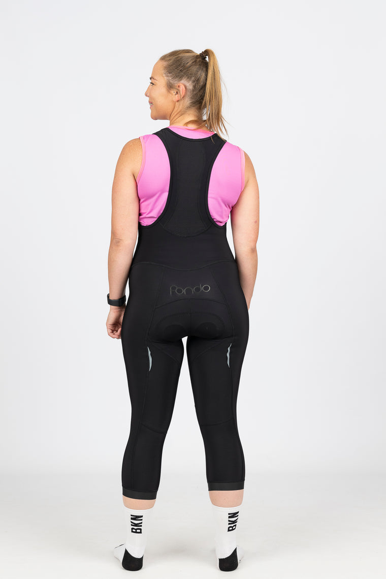 Close up view of our bright pink high wicking mesh cycling baselayer or running singlet.  Mesh fabric keeps you dry by expertly removing sweat and dropped arm holes ensure no chaffing.