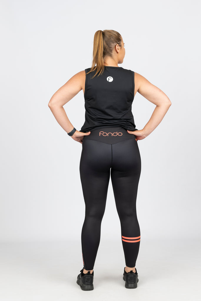 High waist black leggings with side pocket and orange logo at the back and stripe on calf