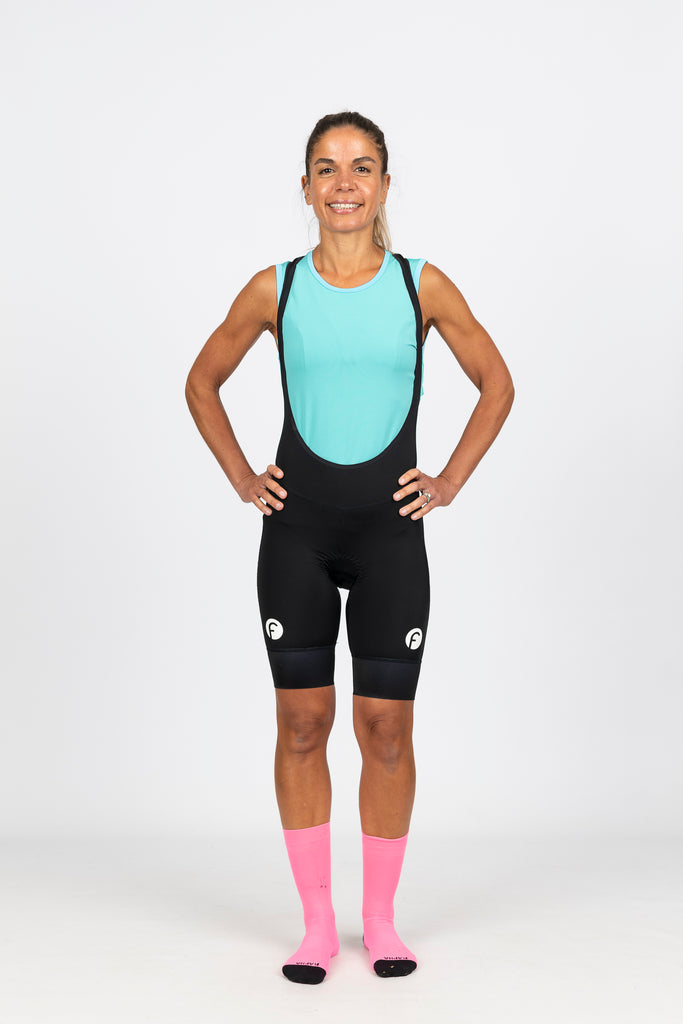 Bright aqua blue high wicking mesh cycling baselayer with high neck keeps you warm but dry on cooler mornings on the bike.  Made with soft silky mesh that offers UPF 50+ sun protection and low arm holes to avoid chaffing.  Team with our women's specific, flattering black cycling knicks with white fondo logo and high density chamois for ultimate comfort on the bike.